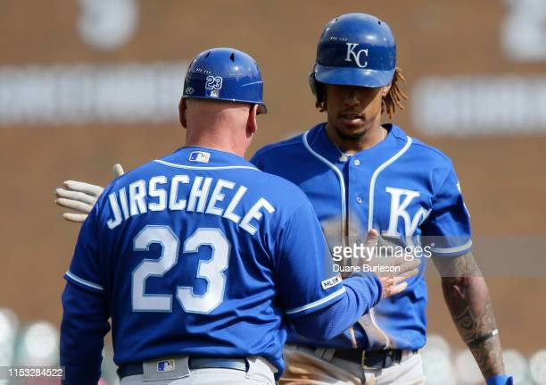 Adalberto Mondesi of the Kansas City Royals celebrates a triple with third base coach Mike Jirschele of the Kansas City Royals during the second...