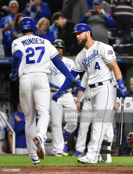 Adalberto Mondesi of the Kansas City Royals celebrates his home run with Alex Gordon in the third inning against the Cleveland Indians at Kauffman...