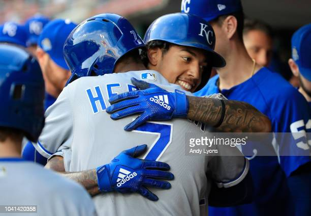 Adalberto Mondesi of the Kansas City Royals celebrates Rosell Herrera after scoring in the first inning against the Cincinnati Reds at Great American...
