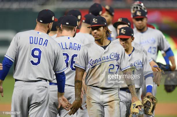Adalberto Mondesi of the Kansas City Royals celebrates with teammates after a 7-4 victory against the Washington Nationals at Nationals Park on July...