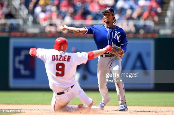 Adalberto Mondesi of the Kansas City Royals forces out Brian Dozier of the Washington Nationals to start a double play in the eighth inning at...