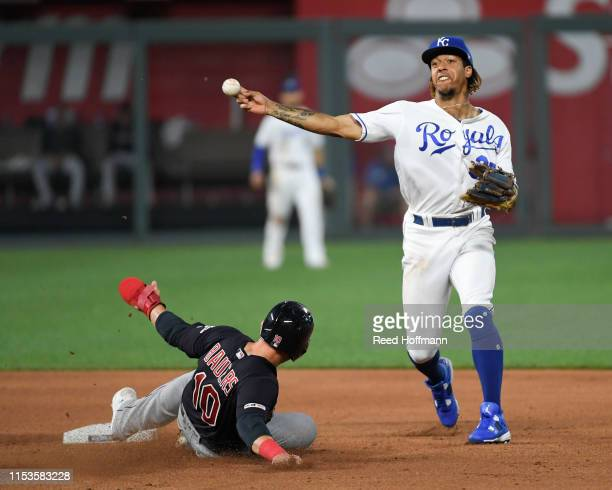 Adalberto Mondesi of the Kansas City Royals forces out Jake Bauers of the Cleveland Indians for the first half of a double play in the seventh inning...