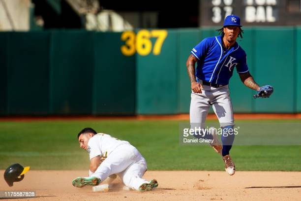 Adalberto Mondesi of the Kansas City Royals gets the force out at second base against Ramon Laureano of the Oakland Athletics during the tenth inning...
