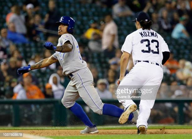Adalberto Mondesi of the Kansas City Royals is chased down and tagged out by shortstop Pete Kozma of the Detroit Tigers after getting caught in a...