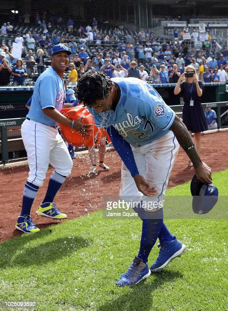 Adalberto Mondesi of the Kansas City Royals is doused with water by catcher Salvador Perez after the Royals defeated Detroit Tigers 92 to win the...