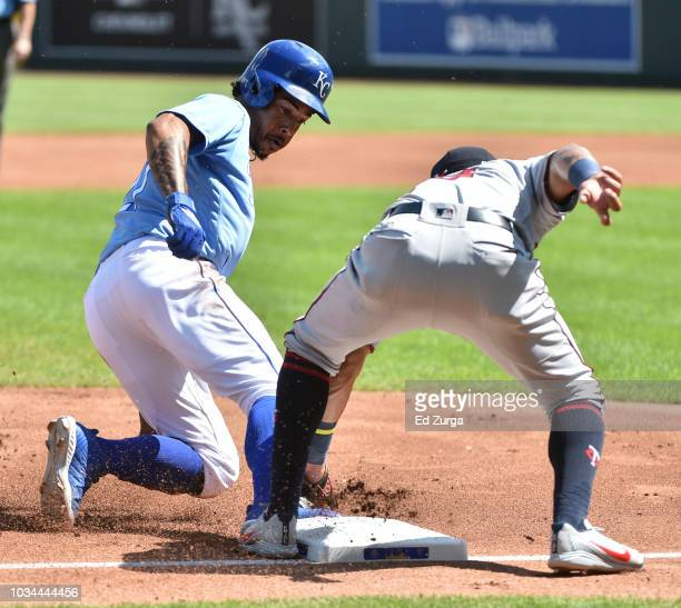Adalberto Mondesi of the Kansas City Royals is tagged out by third baseman Ehire Adrianza of the Minnesota Twins as he tries to steal third in the...