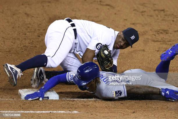 Adalberto Mondesi of the Kansas City Royals is tagged out trying to get back to first base after a dropped infield fly ball by Jonathan Schoop of the...