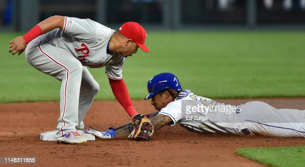 Adalberto Mondesi of the Kansas City Royals slides into second for a steal past the tag of second baseman Cesar Hernandez of the Philadelphia...