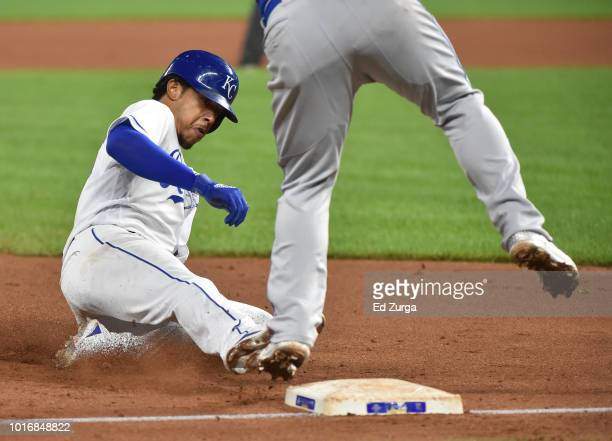 Adalberto Mondesi of the Kansas City Royals slides into third for a steal past the tag of Russell Martin of the Toronto Blue Jays in the third inning...