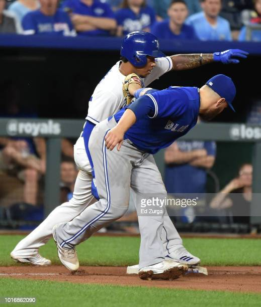 Adalberto Mondesi of the Kansas City Royals slides into third for a steal past Russell Martin of the Toronto Blue Jays in the sixth inning at...