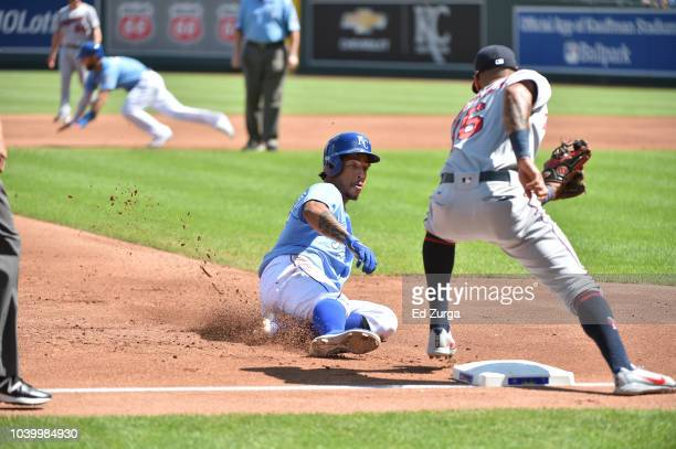 Adalberto Mondesi of the Kansas City Royals slides into third on an attempted steal against third baseman Ehire Adrianza of the Minnesota Twins at...