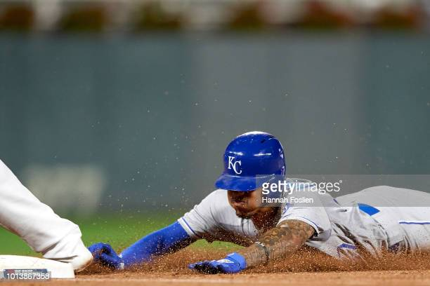 Adalberto Mondesi of the Kansas City Royals slides safely into third base against the Minnesota Twins during the game on August 3 2018 at Target...