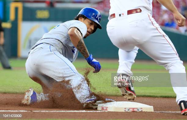 Adalberto Mondesi of the Kansas City Royals slides safely into third base for a steal in the first inning against the Cincinnati Reds at Great...