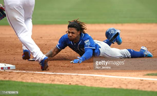 Adalberto Mondesi of the Kansas City Royals slides safely into third base for a triple against the Texas Rangers during the third inning at Globe...