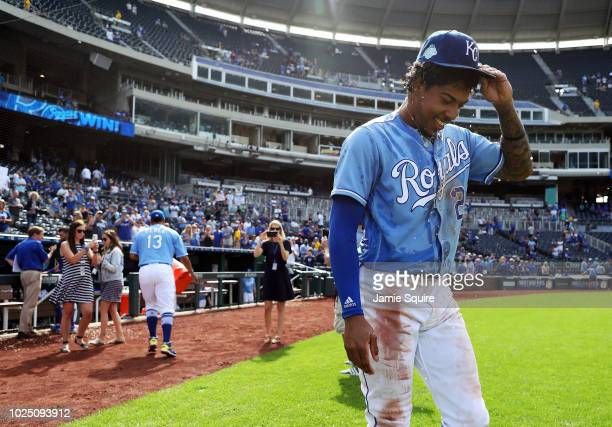 Adalberto Mondesi of the Kansas City Royals smiles after being doused with water by catcher Salvador Perez after the Royals defeated Detroit Tigers...
