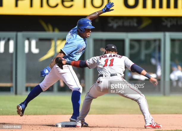 Adalberto Mondesi of the Kansas City Royals stands up on second for a steal past the tag of shortstop Jorge Polanco of the Minnesota Twins in the...