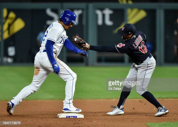 Adalberto Mondesi of the Kansas City Royals stands up on second for a steal past the tag of Francisco Lindor of the Cleveland Indians in the 10th...