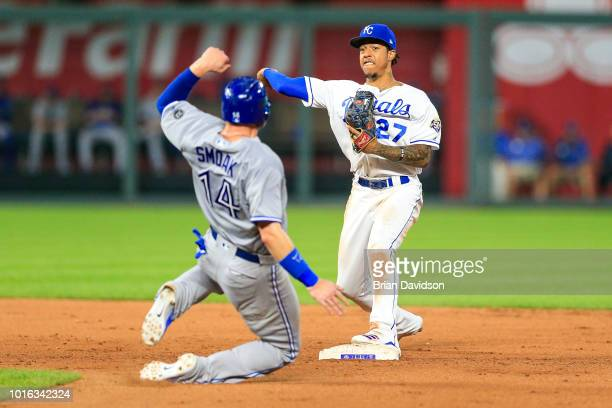 Adalberto Mondesi of the Kansas City Royals starts a double play over Justin Smoak of the Toronto Blue Jays in the ninth inning to win the game at...