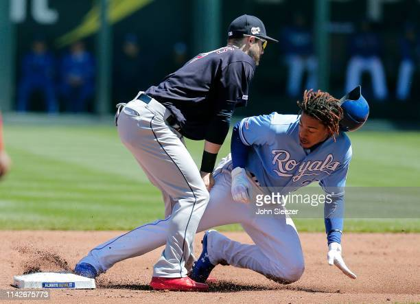 Adalberto Mondesi of the Kansas City Royals steals second base ahead of the tag from Eric Stamets of the Cleveland Indians in the first inning during...