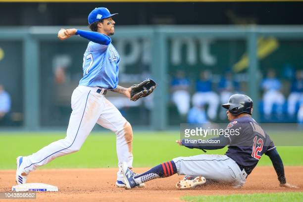 Adalberto Mondesi of the Kansas City Royals works a double play against Francisco Lindor of the Cleveland Indians during the fifth inning at Kauffman...