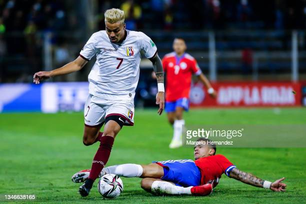 Adalberto Peñaranda of Venezuela fights for the ball with Sebastian Vegas of Chile during a match between Chile and Venezuela as part of South...