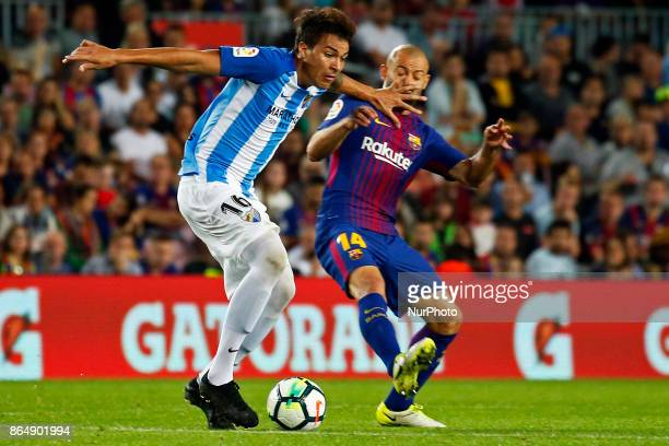 Adalberto Penaranda and Javier Mascherano during La Liga match between FC Barcelona v Malaga CF in Barcelona on October 21 2017