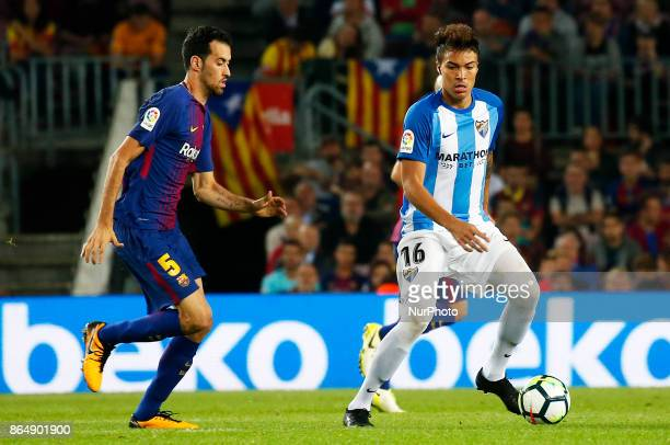 Adalberto Penaranda and Sergi Busquets during La Liga match between FC Barcelona v Malaga CF in Barcelona on October 21 2017