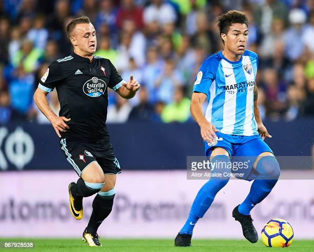 Adalberto Penaranda of Malaga CF being followed by Stanislav Lobotka of Celta de Vigo during the La Liga match between Malaga and Celta de Vigo at...