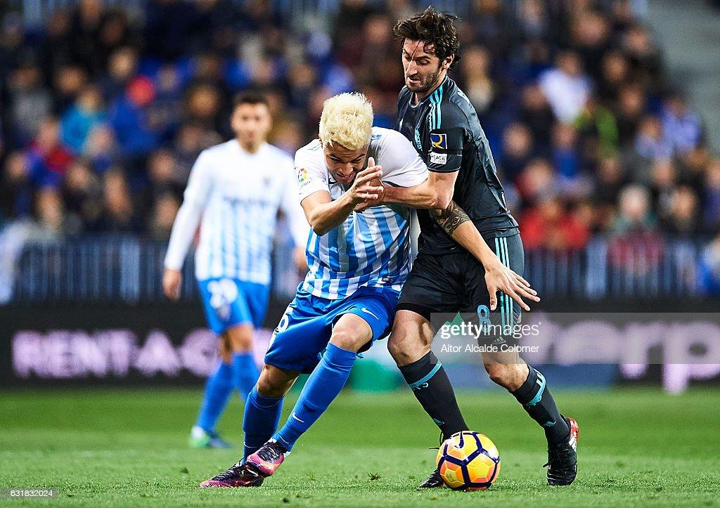 Adalberto Penaranda of Malaga CF (L) competes for the ball with Esteban Granero of Real Sociedad (R) during the La Liga match between Malaga CF and Real Sociedad de Futbol at La Rosaleda Stadium on January 16, 2017 in Malaga, Spain.