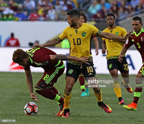 Adalberto Penaranda of Venezuela and Jobi McAnuff of Jamaica battle for the ball during a match in the 2016 Copa America Centenario at Soldier Field...