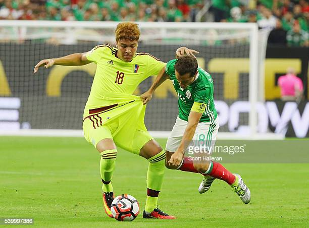 Adalberto Penaranda of Venezuela fights for the ball with Andres Guardado of Mexico during the 2016 Copa America Centenario Group match between...