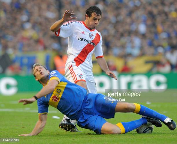 Adalberto Roman from River Plate fights for the ball with Martin Palermo from Boca Juniors during an Argentinean Superclasico between Boca and River...