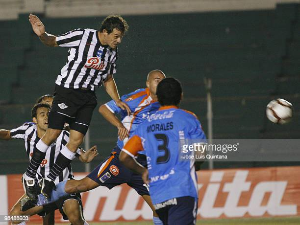 Adalberto Roman of Libertad heads the ball to score a goal during a match against Blooming at Ramon Aguilera Costa Stadium on April 15 2010 in Santa...