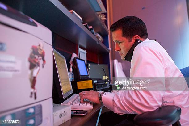 Adam Adam Schefter who has been an NFL Insider at ESPN for five years sits at office desk at ESPN Headquarters in Bristol Conn on Monday August 18...