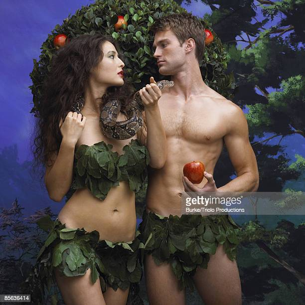 adam and eve in garden of eden - garden of eden old testament stock photos and pictures