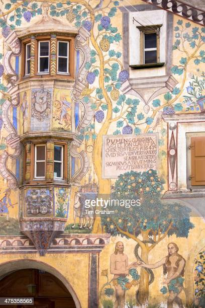 Adam and Eve mural and Romansch inscription in Engadine Valley village of Ardez with painted 17th Century houses Switzerland