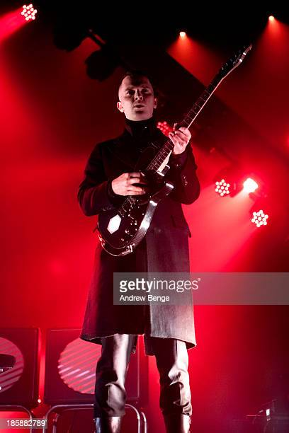 Adam Anderson of Hurts performs on stage at Manchester Apollo on October 25 2013 in Manchester England