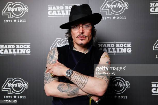 Adam Ant poses for portriats in the Hard Rock Cafe VIP Tent during the third and final day of Hard Rock Calling at Hyde Park on June 26 2011 in...