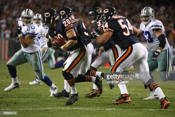 Adam Archuleta of the Chicago Bears advances the ball after teammate Israel Idonije blocked a field goal attempt against the Dallas Cowboys at...