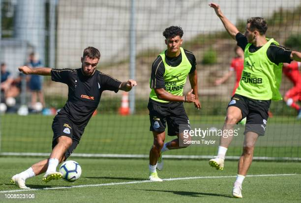 Adam Armstrong controls the ball whilst being challenged by Josef Yarney and Jamie Sterry during the Newcastle United Pre Season Training Session at...