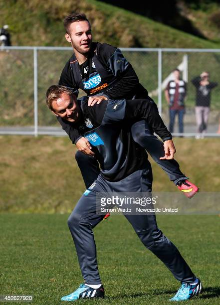 Adam Armstrong hitches a ride on the back of Siem De Jong during a Newcastle United training session at Newtown on July 25, 2014 in Wellington, New...