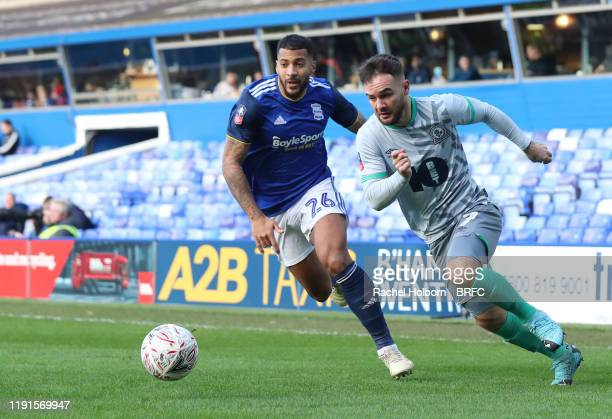 Adam Armstrong of Blackburn Rovers and Birmingham City's David Davis during the FA Cup Third Round match between Birmingham City and Blackburn Rovers...