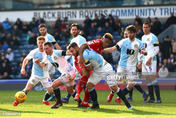 Adam Armstrong of Blackburn Rovers battles for the ball with Britt Assomalonga of Middlesbrough FC during the Sky Bet Championship match between...