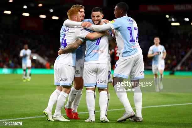 Adam Armstrong of Blackburn Rovers celebrates with teammates after scoring his team's second goal from the penalty spot during the Carabao Cup Third...