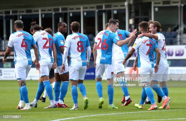 Adam Armstrong of Blackburn Rovers scores his sides first goal and celebrates with his fellow team mates Ben Brereton Darragh Lenihan Joseph...