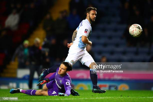 Adam Armstrong of Blackburn Rovers scores his side's first goal past Freddie Woodman of Newcastle United during the FA Cup Third Round Replay match...