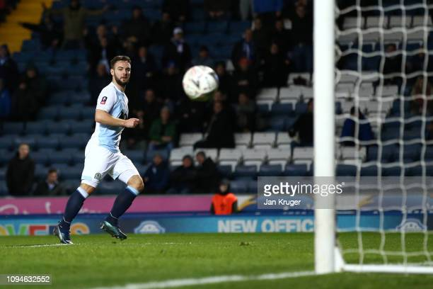 Adam Armstrong of Blackburn Rovers scores his team's first goal during the FA Cup Third Round Replay match between Blackburn Rovers and Newcastle...