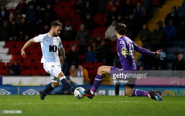 Adam Armstrong of Blackburn Rovers scores his team's first goal past Freddie Woodman of Newcastle United during the FA Cup Third Round Replay match...