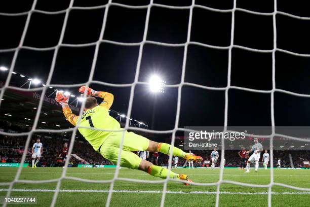 Adam Armstrong of Blackburn Rovers scores his team's second goal from the penalty spot past Artur Boruc of Bournemouth during the Carabao Cup Third...