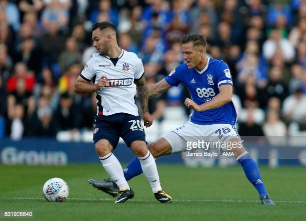 Adam Armstrong of Bolton Wanderers and Michael Morrison of Birmingham City during the Sky Bet Championship match between Birmingham City and Bolton...